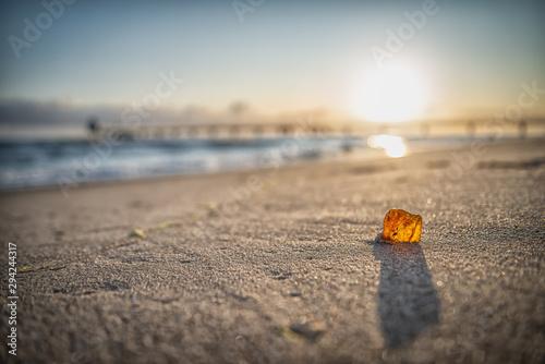 Photo Stands Coast Bernstein am Strand im Sonnenaufgang
