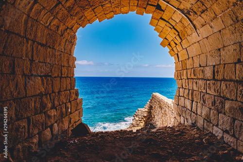Poster de jardin Europe Méditérranéenne Ancient stone fort Malta island made of brick rocks on shore blue sea with view city Valetta