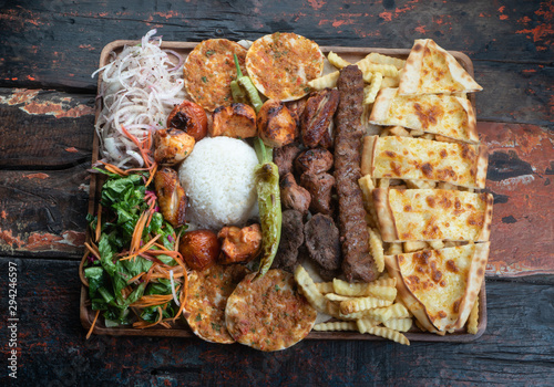 Mixed turkish kebab plate isolated on rustic wooden table Canvas Print