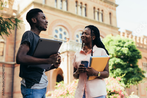 Fotografie, Tablou African male and female college students talking on campus