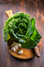 Fresh Raw Savoy Cabbage On Woo...