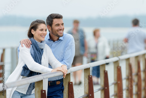 young tourist admiring the view from a bridge Canvas Print