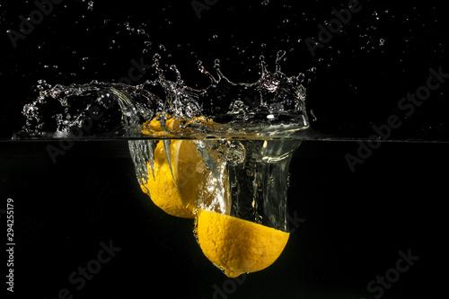 Lemon splashing into water