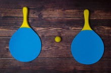 Beach Tennis Racket Set. Beach Paddle Tennis Racket Set With Rubber Ball, On A Wooden Background.