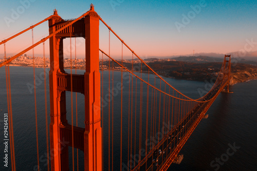 Beautiful aerial San Francisco view at early morning sunrise with Golden gate bridge and downtown Wallpaper Mural
