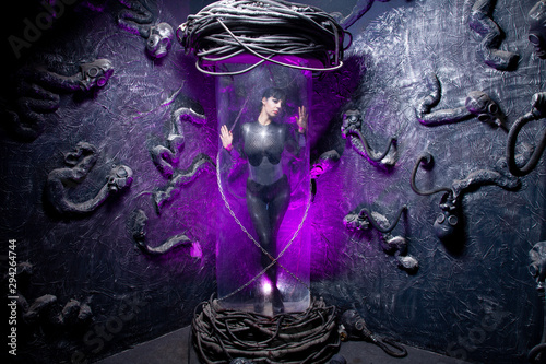Shot of a futuristic young person posing near glass space capsule with wires and Canvas-taulu