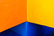 Leinwanddruck Bild - Abstract background of variable geometry and intense yellow and blue colors.
