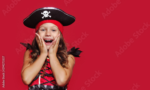 Fototapeta Close-up portrait of surprised girl dressed as pirate