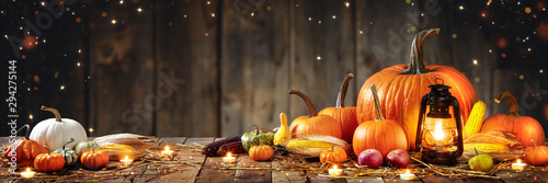 Fototapeta Wooden Table With Lantern And Candles Decorated With Pumpkins, Corncobs, Apples And Gourds With Wooden Background - Thanksgiving / Harvest Concept obraz