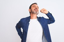 Middle Age Handsome Man Wearing Blue Denim Shirt Standing Over Isolated White Background Stretching Back, Tired And Relaxed, Sleepy And Yawning For Early Morning