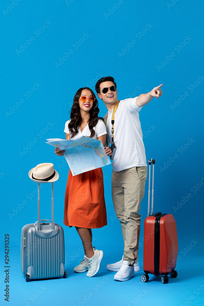 Fototapety, obrazy: Tourist couple with baggage in blue studio background