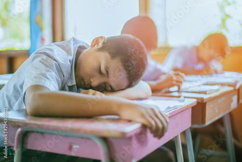 Fototapeta Students are sleeping on the desk in the classroom obraz na płótnie