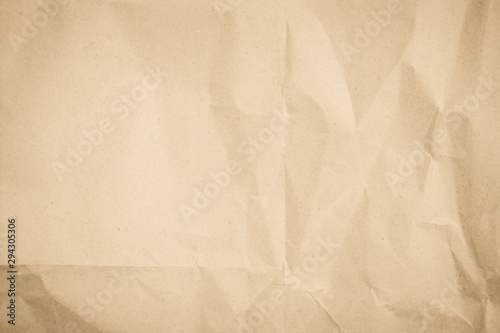 Brown recycled craft paper texture as background. Cream paper texture, Old vintage page or grunge vignette. Pattern rough art creased grunge letter. Hardboard with copy space for text.