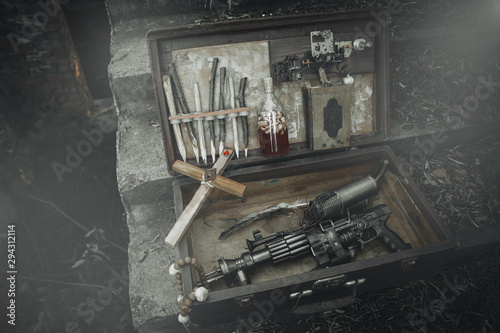 Photo A set of things hunter evil spirits, demons, vampires in an old suitcase