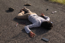 Concept Of Crime Scene ,High Angle View Of Victim Dead Body Lying On Roadside.