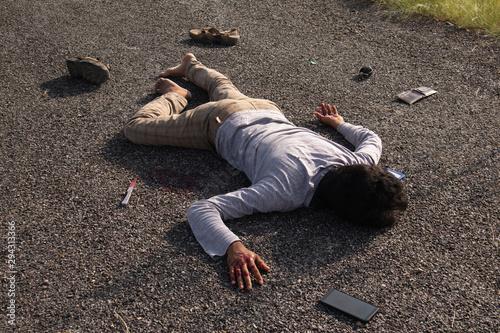 Concept of Crime scene ,High Angle view of victim dead body lying on Roadside Fototapeta