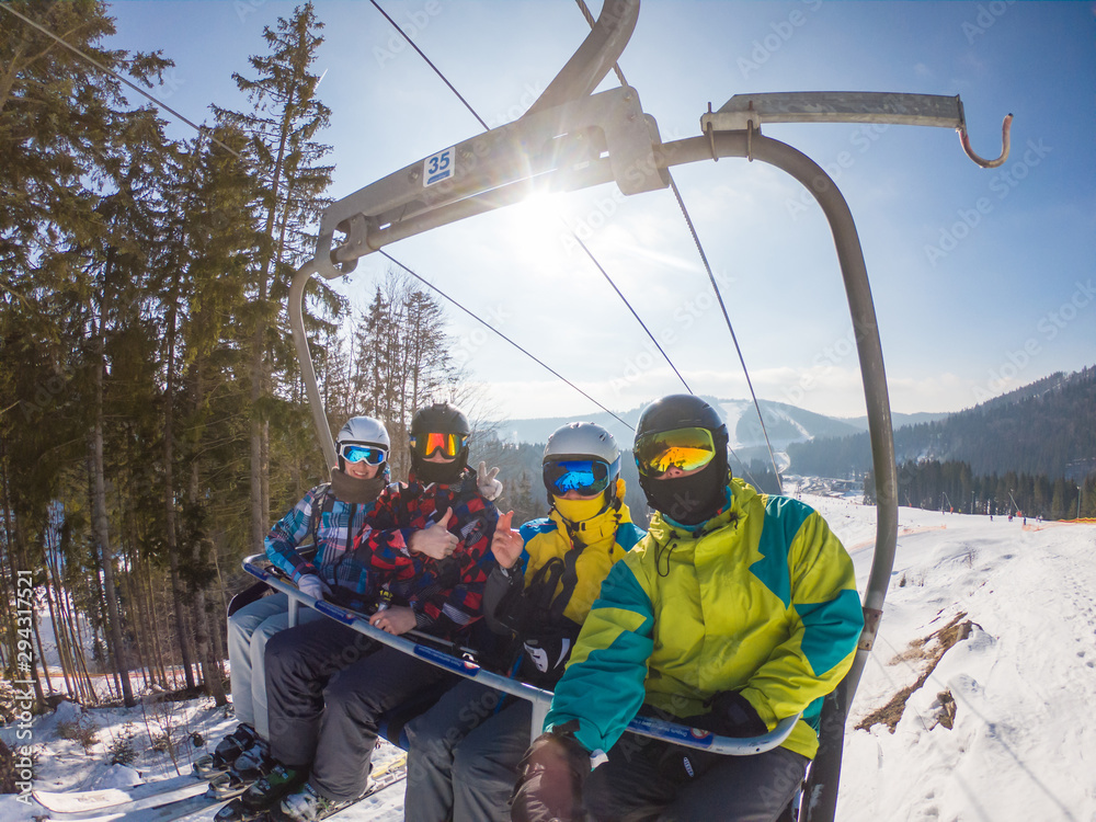 Fototapety, obrazy: friends in ski lift taking selfie