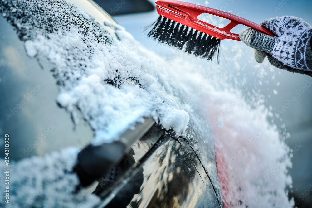 Fototapety, obrazy: Cleaning snow from car window. Removing snow from windshield.