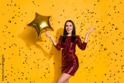 Portrait of her she nice-looking attractive charming lovely glamorous cheerful cheery girl holding in hands air ball having fun hen isolated on bright vivid shine vibrant yellow color background