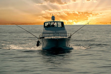 Small Touristic Fishing Boat Returning In Harbor At Sunset