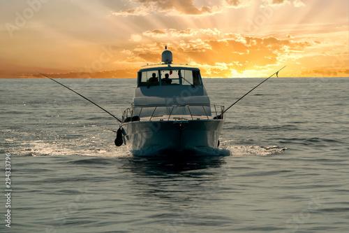 Canvastavla small touristic fishing boat returning in harbor at sunset