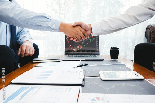 Fototapeta Business Team shaking hands with Investment Entrepreneur Trading discussing and analysis graph stock market trading,stock chart concept obraz