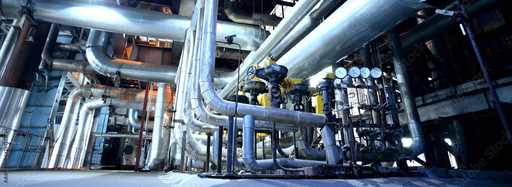 Fototapeta Industrial Steel pipelines, valves, cables and walkways