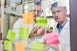 Leinwandbild Motiv Two doctors carefully read notes with ideas