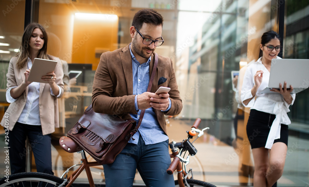Fototapety, obrazy: View at young business people talking and smiling outdoors