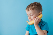 Little Boy Tries To Speak By Means Of A Banana Instead Of Phone.