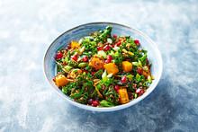 Hokkaido Pumpkin And Quinoa Salad With Kale, Pomegranate, Spring Onion And Toasted Sunflower Seeds. Healthy Homemade Food. Vegan Food