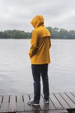 Young Man Wearing Yellow Rainc...