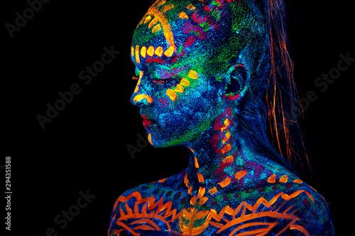 Leinwand Poster  UV body art painting of helloween female african warrior