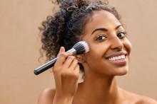 Black Beauty Woman Using Makeup Brush
