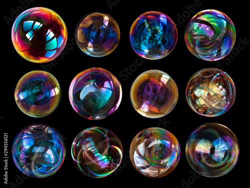 Fotografía  Group of soap bubbles isolated on black background.