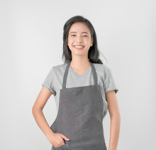 Asian Woman In Apron And Stand...