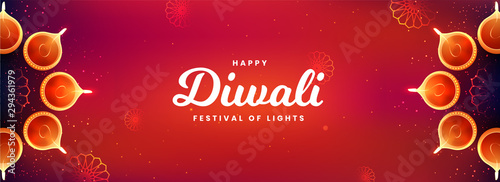 Fototapeta Top view of social media header or banner design decorated with illuminated oil lamps on glossy red background for Happy Diwali celebration. obraz