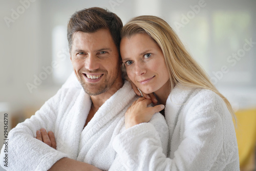 Young casual couple in white bathrobe - 294362710