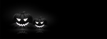 Spooky, Illuminated Jack-o-lanterns On Black Background With Space For Your Text. Website Header Design For Halloween Celebration.