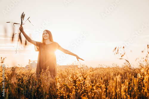 woman in wheat field Canvas Print