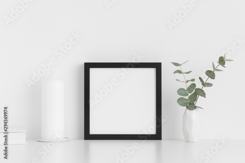 Fototapety, obrazy: Black square frame mockup with workspace accessories and eucalyptus in a vase on a white table.