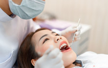 Woman Having Dental Teeth Examined Dentist Check-up Via Excavator In Clinic