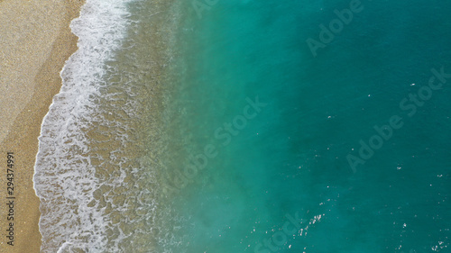 Aerial drone top down photo of tropical exotic sandy bay with emerald sea and waves