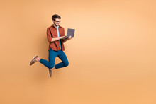 Full Length Body Size View Of His He Nice Attractive Cheerful Cheery Successful Brunet Guy Jumping In Air Using Laptop Home-based Job Isolated Over Beige Color Pastel Background