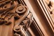 Carved decoration of vintage wooden cabinet
