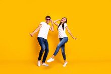 Full Body Photo Of Two People Dancing At First Season Theme Party Wear Cool Specs And Casual Clothes Isolated Yellow Color Background