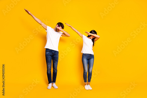 Full body photo of two people dancing at theme party cool modern moves wear casual clothes isolated yellow color background - 294385306