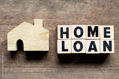 Photo Letter block with word home loan and home model on wood background
