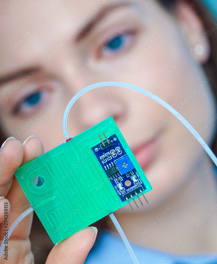 Fototapeta Girl holding polymers Bio-MEMS biomedical microelectromechanical systems / LOC lab-on-a-chip device (concept design)