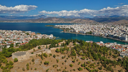 Aerial drone photo of famous castle of Karampampa built on top of hill in seaside town of Halkida or Chalkida, Evia island, Greece
